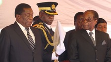 Emmerson Mnangagwa and Robert Mugabe