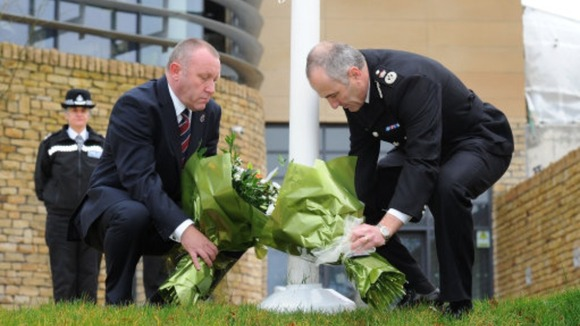 Temp Chief Constable Tim Madgwick and Mike Stubbs from the North Yorkshire Police Federation lay flowers outside Harrogate Police Station