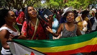 Zimbabweans praying