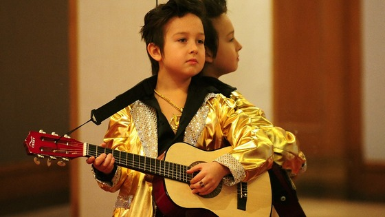 Andrejus Rascinski, aged nine, from Birmingham, waits to perform during the under-14 European Elvis Championships.