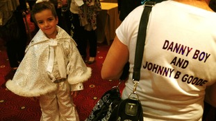 John Paul Melling,6, alias Johnny B Goode from Billinge, waits to perform during the under-14 European Elvis Championships in Birmingham.