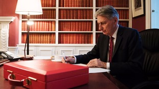 Philip Hammond prepares his speech in his office in Downing Street