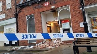 Thieves rip cash machine out of bank wall before leaving it behind