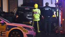 Driver flees after car smashes into house
