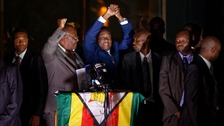 Mugabe's successor heralds 'new and unfolding democracy'
