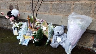 Tributes were left at the scene in memory of the boy last year.