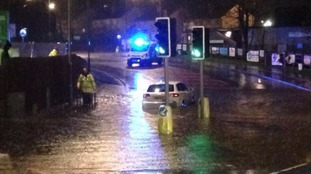 Dozens rescued as flooding hits north west of England and Wales