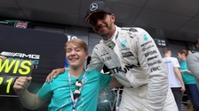 Billy Monger pictured with Formula 1 World Champion Lewis Hamilton.