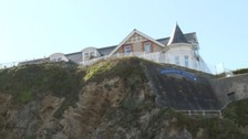 Newquay residents are celebrating after a developer has withdrawn plans to build apartments on a clifftop.