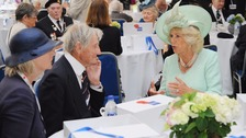 Jim Booth (centre) speaking to the Duchess of Cornwall at the 70th anniversary of VJ Day.