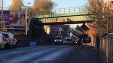 Lorry stuck under bridge in Leeds