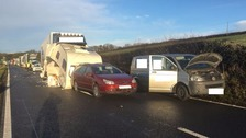 Lorry crashes into car towing caravan on the A75