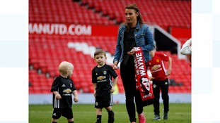 Coleen Rooney with two of her sons, Kit and Klay at Old Trafford.