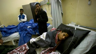 A 14-year-old boy wounded in the attack lies in hospital.