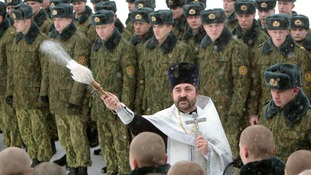 An Orthodox priest blesses servicemen of the Belarussian Interior Ministry's special unit