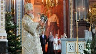 Patriarch Kirill leads a Christmas service attended by Prime Minister Dmitry Medvedev in the Cathedral of Christ the Saviour in Moscow