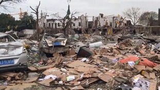 Buildings were destroyed and the streets were littered with debris from the blast.
