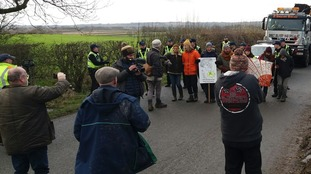 Protesters held a 20-minute 'slow walk' protest in front of a convoy of lorries