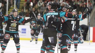 The Giants celebrate their win over the Devils in Cardiff.