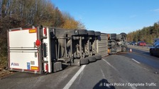 The overturned lorry on the M11
