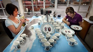 plates and mugs celebrating the engagement of Prince William and Kate Middleton being prepared at the Aynsley China works in Longton near Stoke on Trent