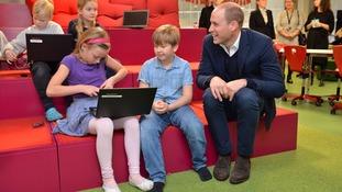 Prince William meets schoolchildren.