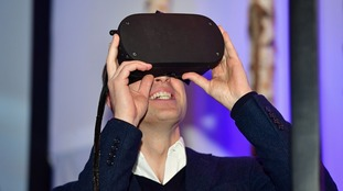 Prince William tries out a virtual reality headset.
