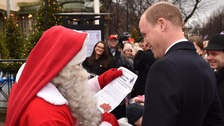 Prince William meets Father Christmas.