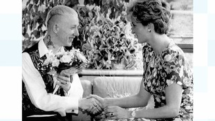 Princess Diana shaking hands with Aids patient William Drake in 1992.