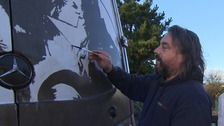 Rick Minns is also known as Ruddy Muddy because of the artwork he creates in the filth on white vans.