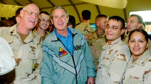 Former US President George W. Bush visits troops stationed in Iraq in 2003