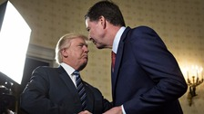 Donald Trump shakes hands with James Comey