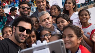 Mayor of London Sadiq Khan poses for a photograph with young footballers and Bollywood actor Ranbir Kapoor