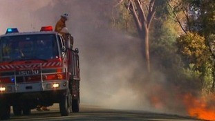 Firefighters tackle a bushfire in New South Wales, Australia