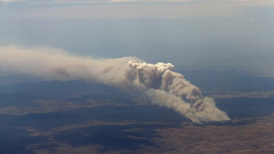 Smoke rises from the Yarrabin bushfire, burning out of control near Cooma, about 100km (62 miles) south of Canberra