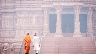 Sadiq Khan walks with Swami Sadhu Gnanmunidas during a visit to Akshardham Temple in Delhi