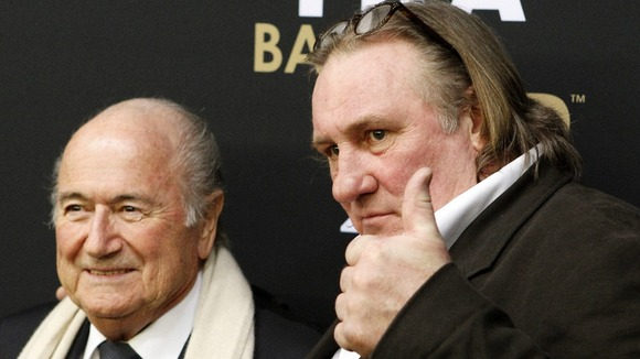 Gerard Depardieu arrives with Sepp Blatter at the Ballon d'Or gala on Monday