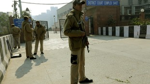 Policemen standing guard outside the court in New Delhi