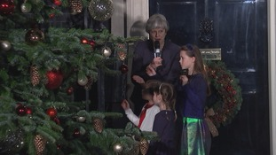 Theresa May was joined by children from her Maidenhead constituency to switch on the lights of the Downing Street Christmas tree.