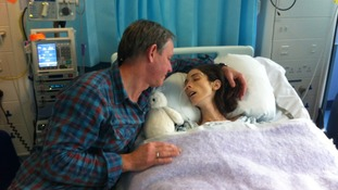 Averil with her father in hospital