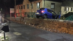 The car crashed into the fence
