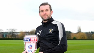 Nathan Jones shows off his trophy.