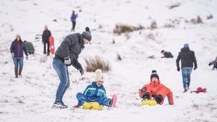 family enjoying snow