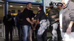 Israeli authorities arrest a suspect after a security guard was stabbed.