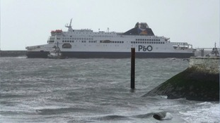 Tug boats work to refloat the P&O ferry
