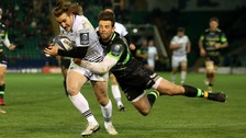 Ospreys' Jeff Hassler scores their sixth try evading Northampton Saints' Ben Foden during the European Rugby Champions Cup, Pool Two match