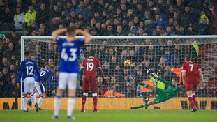 Wayne Rooney's penalty enables Everton to gain a point against rivals Liverpool