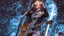 Queens of the Stone Age singer sorry after kicking journalist