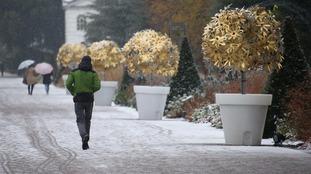 Visitors walk through Royal Botanic Gardens, in Kew