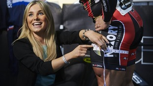 Presenter Sian Welby measures the Olympian's thighs.